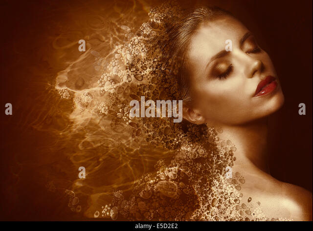 Golden Splatter. Futuristic Woman with Bronzed Painted Skin. Fantasy - Stock Image