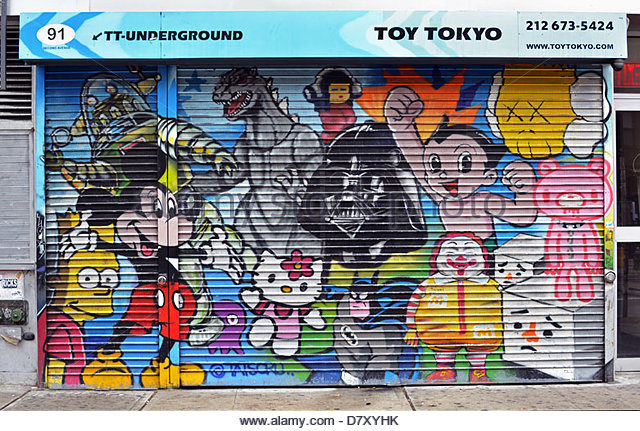 Graffiti painted storefront on Second Avenue in Manhattan at Toy Tokyo store - Stock Image