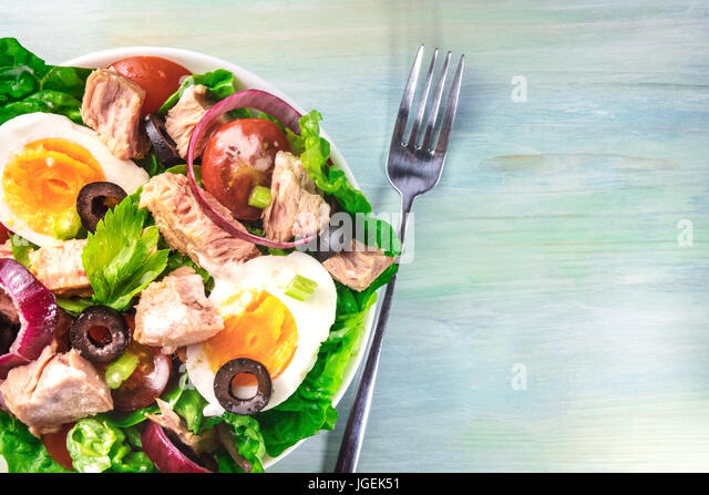 Closeup of tuna salad with fork and copy space - Stock Image