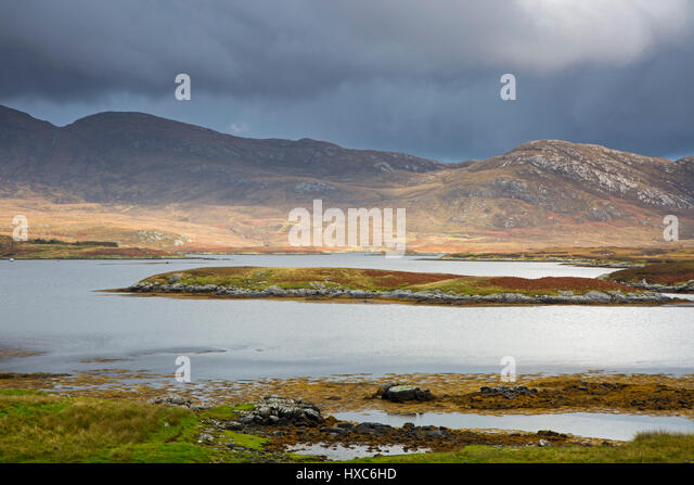 Clouds over craggy hills and lake, Loch Aineort, South Uist, Outer Hebrides - Stock Image