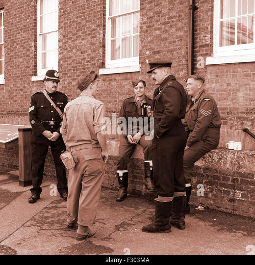 1940s WW2 Re-enactors Policeman and Military - Stock Image