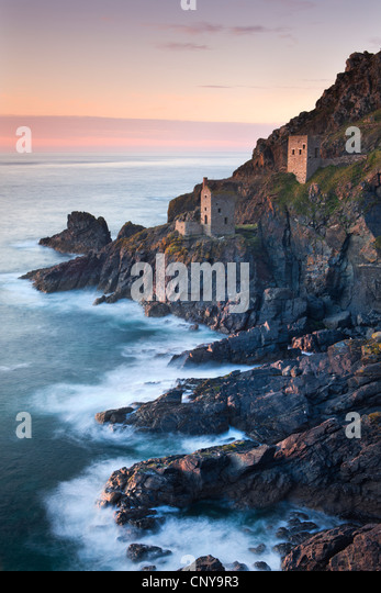 Remains of The Crowns tin mine engine houses on the Cornish Atlantic coast near Botallack, St Just, Cornwall, England. - Stock Image
