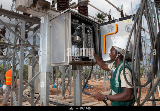 Electrical Engineer Equipment : Voltage power transformer substation village stock photos