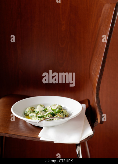 Bowl of food in chair - Stock Image