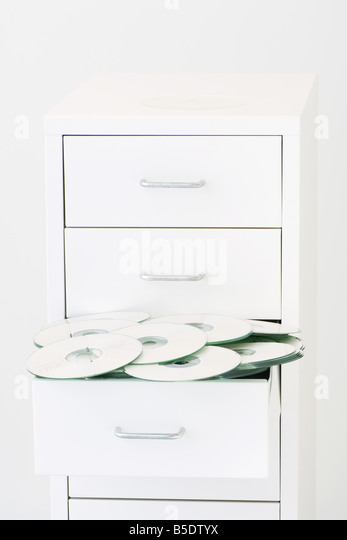 Open drawer overflowing with CDs - Stock Image
