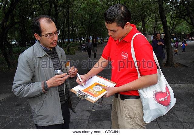 Mexico City Mexico DF D.F. Distrito Federal Paseo de la Reforma Hispanic man boy teen taking survey clipboard Grupo - Stock Image