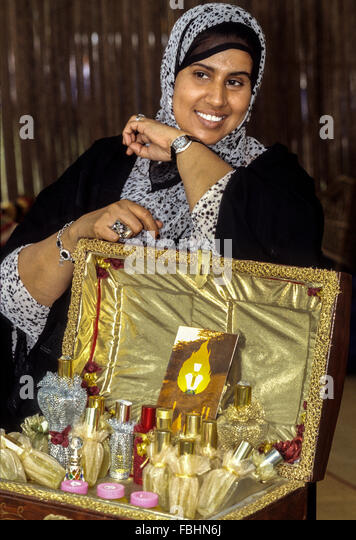 Oman.  Woman Displaying Perfumes, Oman Folklife Festival. - Stock Image
