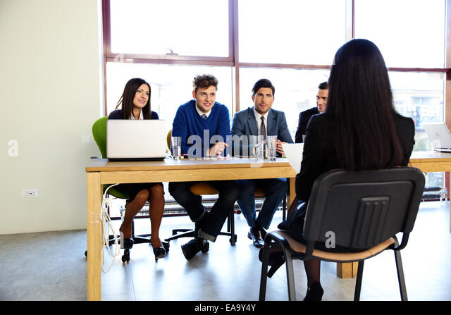Woman sitting at job interview in office - Stock Image