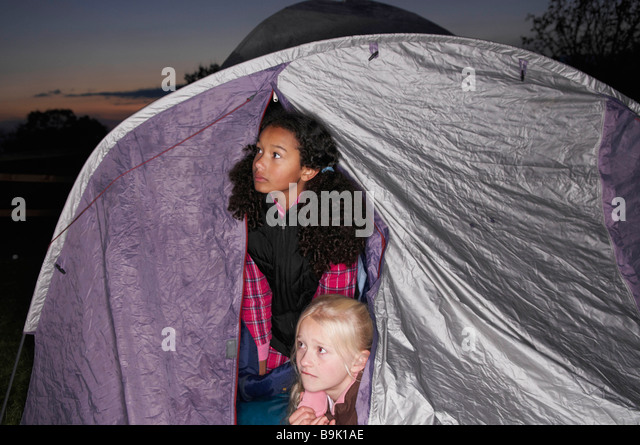 Girls in tent at dusk - Stock Image