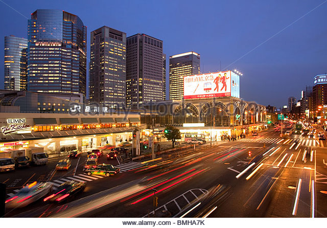 Shinagawa central Train Station with buildings of Shinagawa Intercity, Takanawa Avenue, Shinagawa, Tokyo, Japan - Stock Image