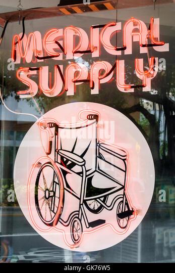 Florida Miami Coral Way shop medical supplies health wheelchair neon light ad advertisement durable Medical Equipment - Stock Image