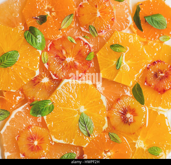Fresh citrus fruit salad with mint and honey, close-up - Stock Image