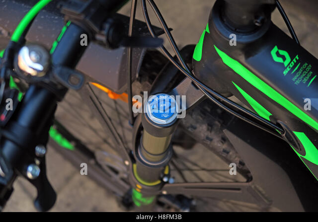 MTB shock pump being used on a Scott Scale 950 Cycle - locate shock cover cap - Stock Image