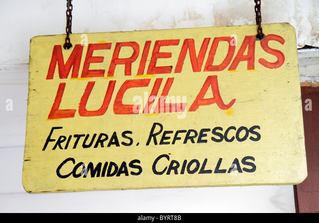 Panama City Panama Bella Vista business food stand rustic sign Spanish language Creole food fritters soft drinks - Stock Image