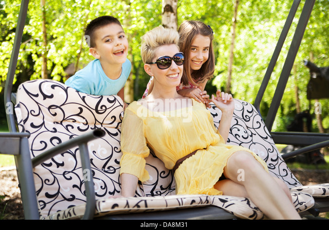Happy family relaxing during sunny holidays - Stock-Bilder