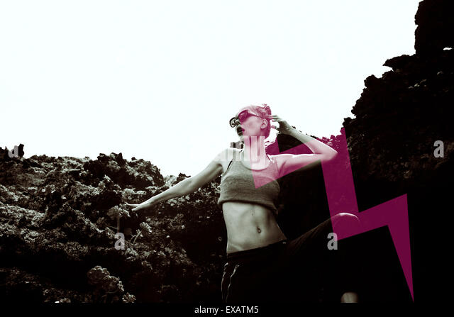 young woman, Fashion pose in the volcano rock - Stock Image