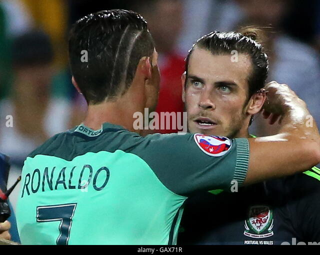 Lyon, France. 6th July, 2016. Portugal's Cristiano Ronaldo (L) and Wales' Gareth Bale after their 2016 UEFA - Stock Image