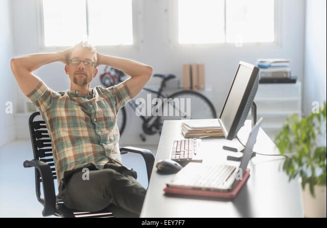 Portrait of man in office - Stock Image