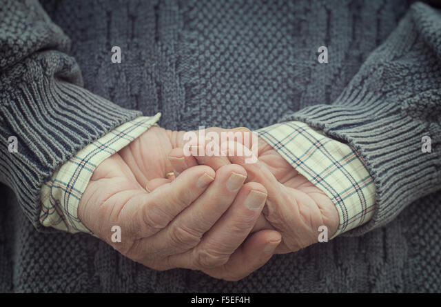 Rear view of a man holding hands behind his back - Stock Image