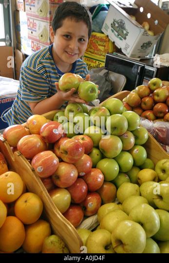 Cleveland Ohio Westside Market produce food apples fruit boy family business - Stock Image