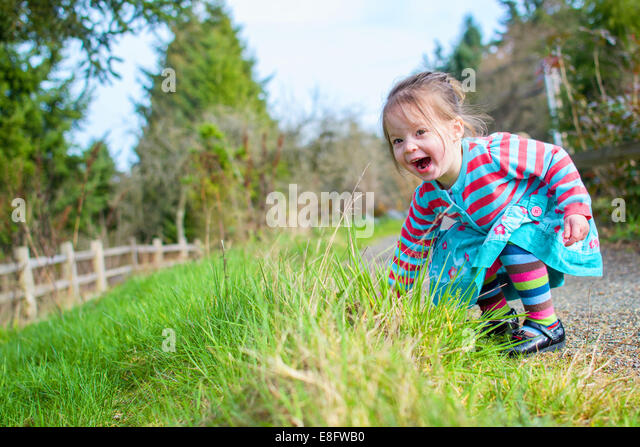 Girl ( 2-3 ) on path laughing - Stock Image