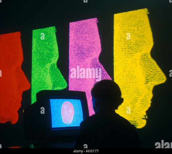 graphic designer with multiple wire frame images on large monitor - Stock Image