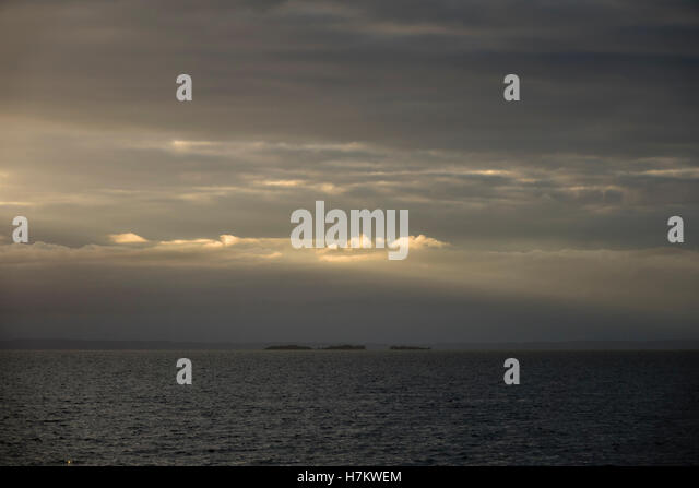 Lake with three small islands at twilight. Tranquil and beautiful nature background. - Stock-Bilder