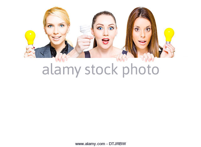 Three business people holding up light bulbs and blank copy space sign in a advertisement for a innovative idea, - Stock Image