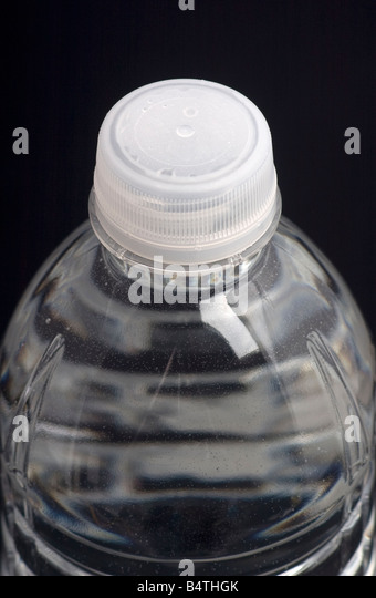 close up of a plastic water bottle on black background - Stock Image