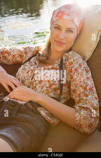 Beautiful woman resting in the boat - Stock Image