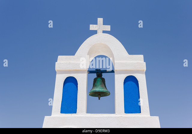 Traditional white bell tower at Oia, Santorini in Greece - Stock Image