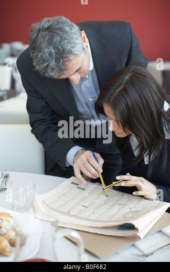 Business people reviewing stock prices - Stock Image