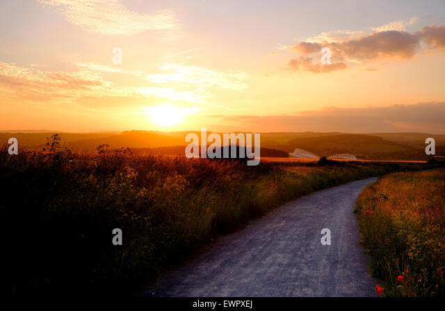 Brighton, 19 June 2015: The sun sets over the South Downs National Park with The American Express Community Stadium - Stock Image