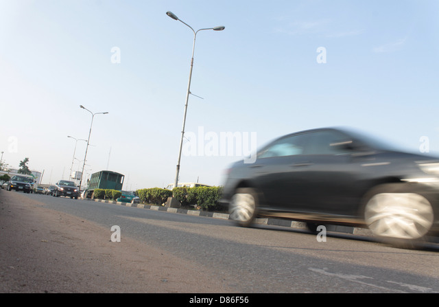 Moving Traffic on a main road in Lagos. - Stock Image