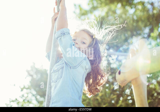 Children climbing outdoors - Stock Image