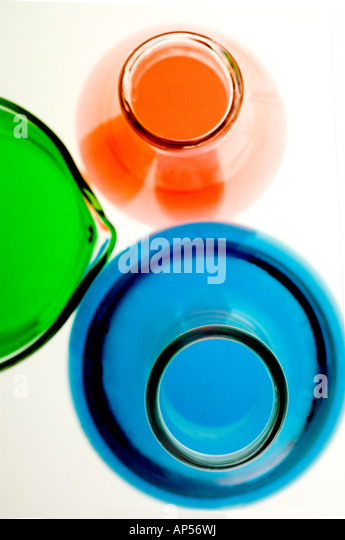Lab flasks and beaker with colored liquids. - Stock Image