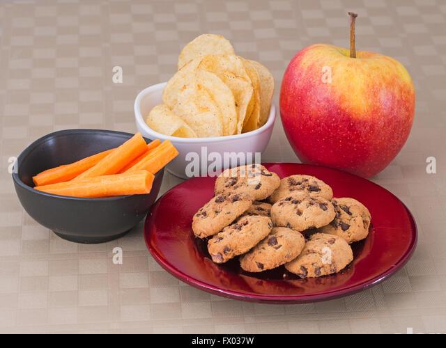 Healthy versus unhealthy food options concept. - Stock Image