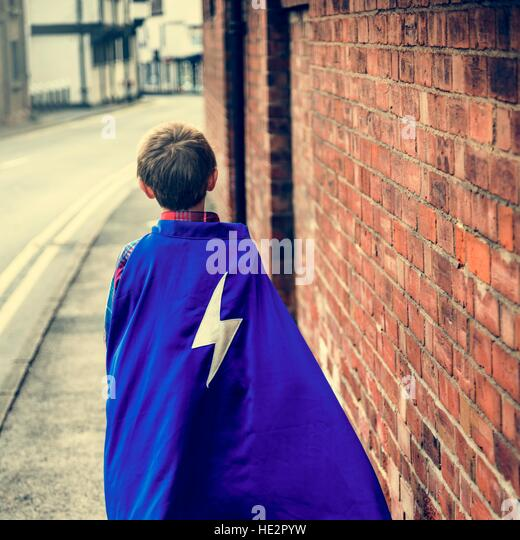 Superhero Little Boy Imagination Freedom Happiness Concept - Stock Image
