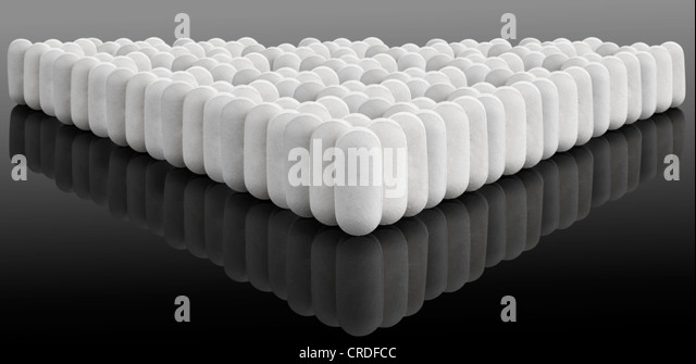 Multiple white pills on gradient - Stock Image