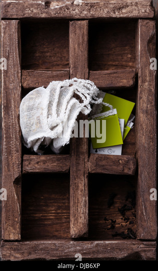 Tea bags in wooden box - Stock Image