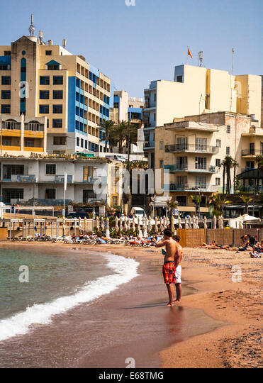 The beach at St George's Bay, Malta. - Stock Image