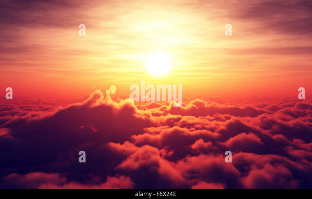 Golden Sunrise above puffy clouds (Digital artwork) - Stock Image