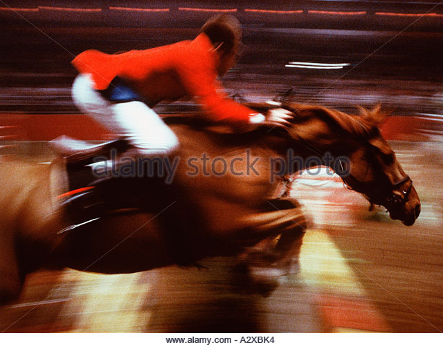 Show jumping man on horse. Speed Impressionist image. - Stock Image