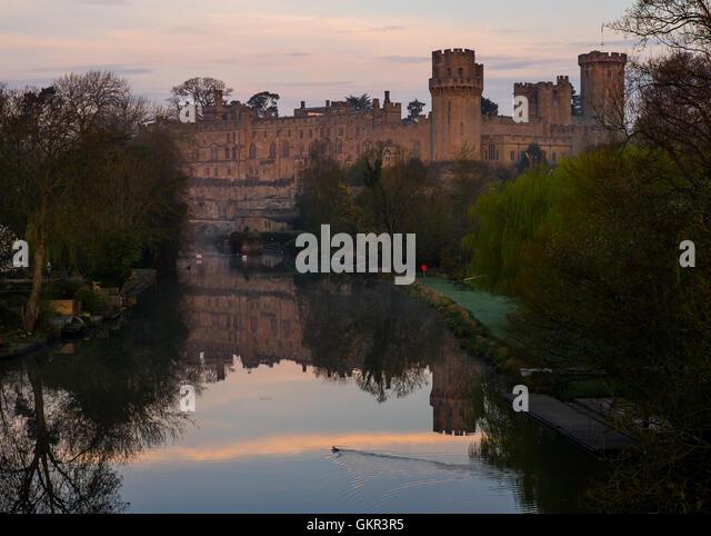 Warwick Castle & the River Avon at dawn. - Stock Image