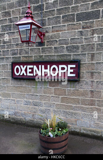 Station nameplate and lantern, Oxenhope, West Yorkshire - Stock Image