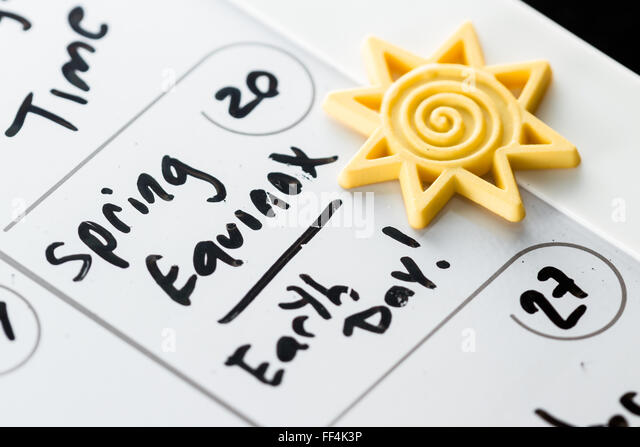 March 20th marked on a calendar as Spring Equinox and also Earth Day concept for 2016 - Stock Image