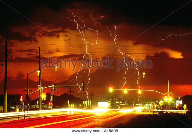 Lightning and Sunset traffic blurs in Tucson Arizona USA - Stock Image