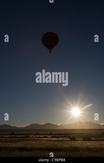 Silhouette of a hot air balloon, near Wellington, Western Cape, South Africa - Stock Image