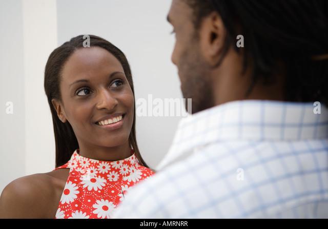 African man smiling at girlfriend - Stock-Bilder