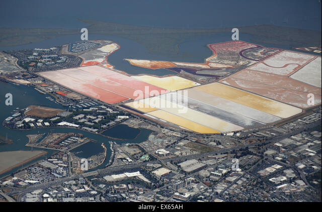 Aerial view over Redwood City harbor and Salt Ponds - Stock Image